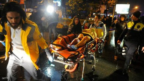 First aid officers carry an injured woman at the site of an armed attack on January 1, 2017 in Istanbul. At least two people were killed in an armed attack Saturday on an Istanbul nightclub where people were celebrating the New Year, Turkish television reports said. / AFP / IHLAS NEWS AGENCY / IHLAS NEWS AGENCY        (Photo credit should read IHLAS NEWS AGENCY/AFP/Getty Images)