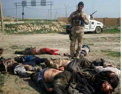 قوات الجيش بمشاركة فعالة من قوات المتطوعين تحكم سيطرتها على معظم انحاء مدينة تكريت وتطهرها من داعش