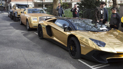 Gold plated cars with parking tickets, Knightsbridge